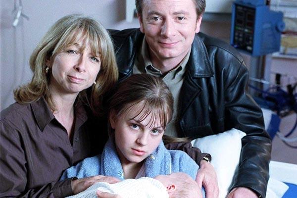 Coronation Street - June 2000 Gail Platt (HELEN WORTH), Martin Platt (SEAN WILSON), Sarah Louise Platt (TINA O'BRIEN) and baby Bethany Platt [Amy & Emily Walton]